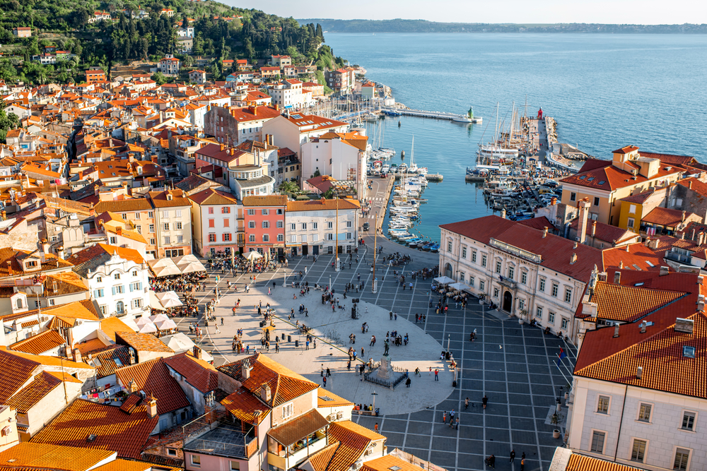 shutterstock_457528951 Beautiful aerial view on Piran town with Tartini main square, ancient buildings with red roofs and Adriatic sea in southwestern Slovenia